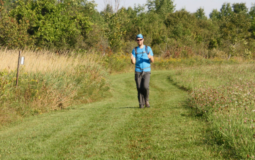 Hiker all smiles with thumbs up near first checkpoint of Bruce Trail Falling Waters challenge. Photo Marg Yaraskavitch 2018.